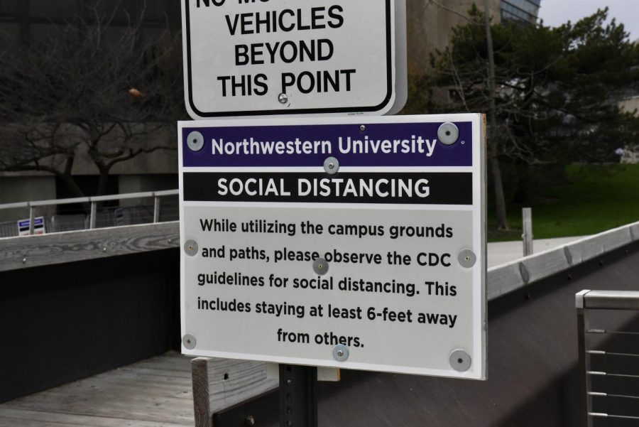 A sign posted by the Lakefill. Northwestern expects community members arriving back on campus to observe CDC guidelines for social distancing.