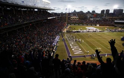 Northwestern fans celebrate a touchdown against Illinois in a 2010 game at Wrigley Field. A Nov. 7 football game between the Wildcats and Wisconsin will no longer take place at the Friendly Confines