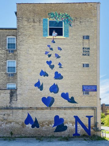 Fifteen purple hearts and a little girl decorate a wall at 829 Foster St.