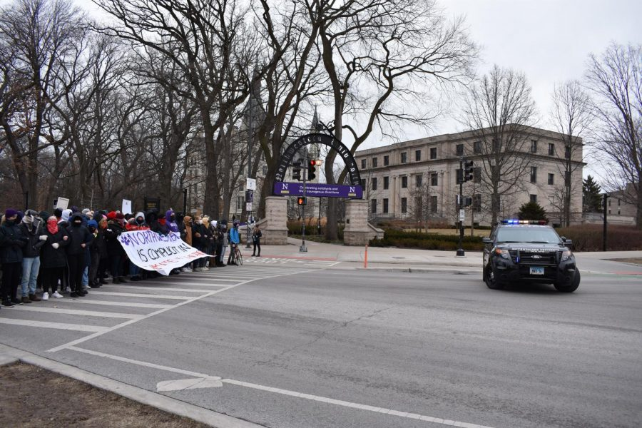 Protesters block Sheridan Road in order to protest the University's investment in fossil fuels, March 6.