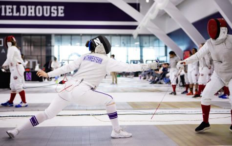 A Northwestern fencer lunges. The team was unable to make it to the finals of the Midwest Championships despite having one of their best seasons in recent years.