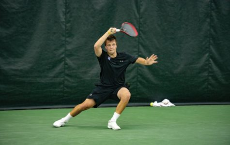 Dominik Stary hits a shot. He collected singles wins against highly-ranked NC State and Harvard teams this season.