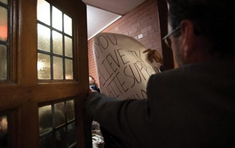 Students attempt to enter Lutkin Hall, where former U.S. Attorney General Jeff Sessions was giving a speech on Nov. 6.
