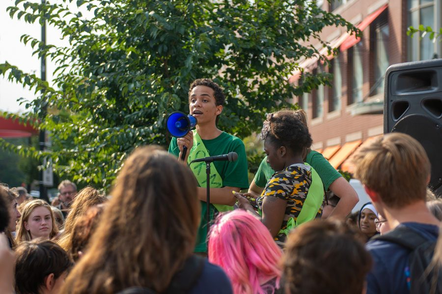 Aldric Martinez-Olson, now-ETHS graduate and student organizer, speaks to the crowd of 400 community members gathered for the climate strike in Sept. 2019.