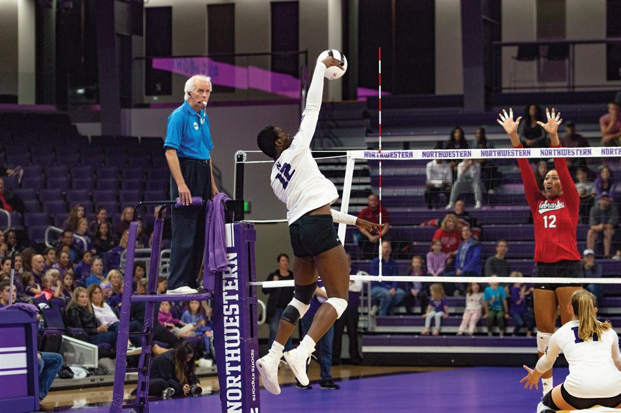 Sophomore outside hitter Temi Thomas-Ailara performs a hit against Nebraska. She finished second in the Big Ten in kills per set last season.