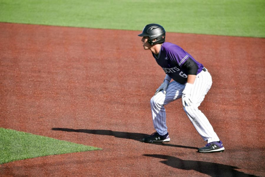 Shawn Goosenberg takes a lead off first base. The junior infielder led the Cats last season with a .444 batting average.