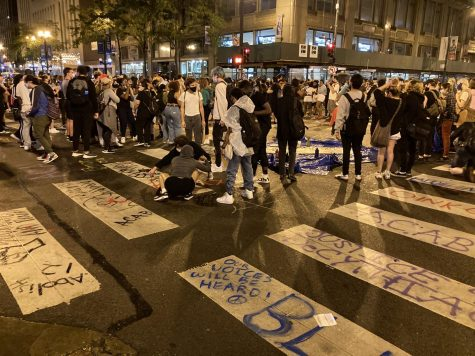 The Loop. Protestors painting the street at the intersection of State Street and Jackson Boulevard at 10 p.m. Saturday.