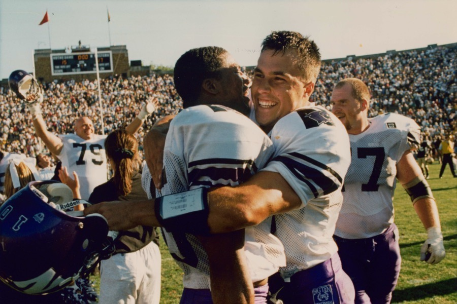 Rodney Ray (left) and Steve Schnur (right) celebrate Northwestern's upset of Notre Dame in 1995. The Wildcats won 17-15.