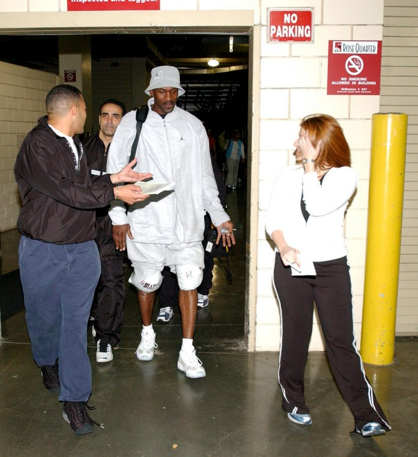 (Courtesy of J.A. Adande)  Left to right: Medill's Director of Sports Journalism J.A. Adande, Michael Jordan's personal trainer Tim Grover, Michael Jordan and Rachel Nichols, after a Washington Wizards practice in 2003.  Adande covered the Chicago Bulls while writing for the Chicago Sun-Times.