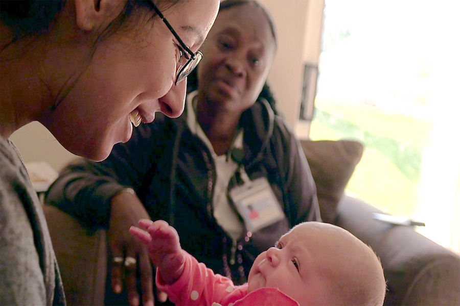 A woman recovering from addiction holds her baby. Jessica Martinaitis (Medill MSJ '19) followed the young mother for her film documenting the repercussions of a Wisconsin law that punishes mothers and pregnant women with substance abuse issues.