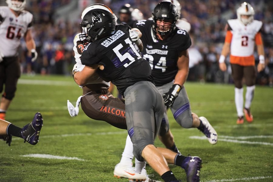Blake Gallagher gets set to make a tackle on the opposing rusher. The senior will be a leader on the defense this fall.