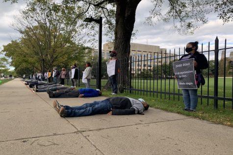 Members of the NU community participate in a die-in protest on Sheridan Road, by Deering Meadow.