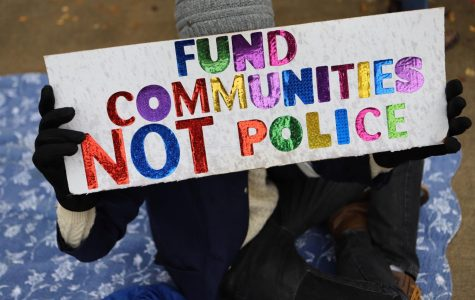 "A sign from Sunday's NU Community Not Cops demonstration outside the Evanston Police Department, reading ""Fund Communities Not Police."""