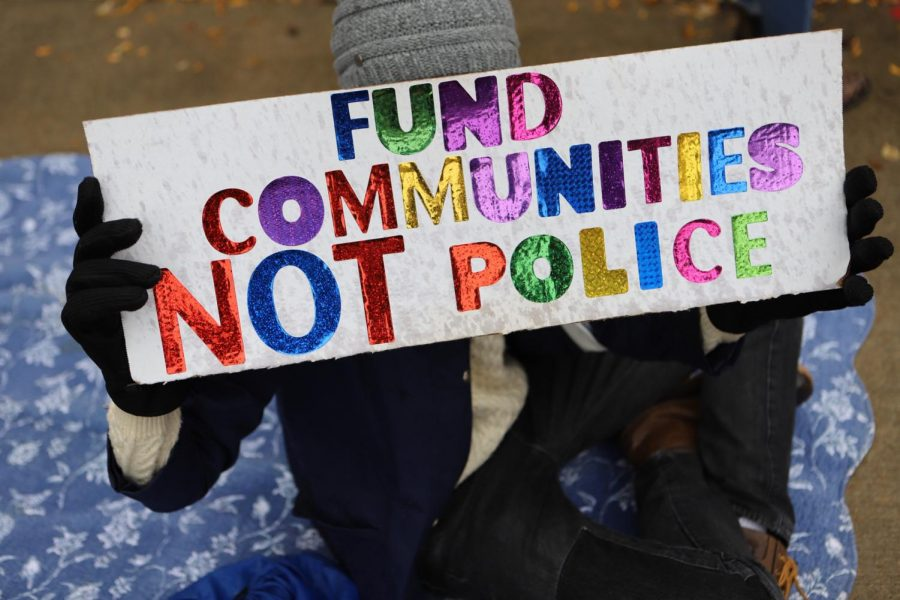 "A sign from a previous NU Community Not Cops demonstration, reading ""Fund Communities Not Police."" Students reimagined justice in a Wednesday discussion led by FMO and NUCNC."