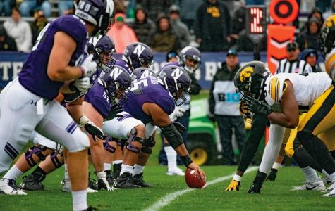 Northwestern's offensive line prepares to block the opposing defensive lineman. With Rashawn Slater opting out of the season, the Cats will turn to freshman Peter Skoronski to replace him.