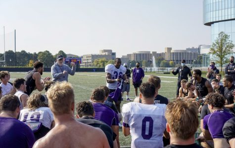 Jesse Brown receives the No. 1 jersey at Northwestern's practice last week.