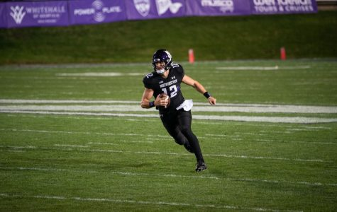 Peyton Ramsey makes a run. The graduate transfer scored two touchdowns in NU's season-opening win over Maryland on Saturday.