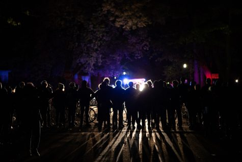 Protesters stand in line at the intersection of Central Street and Orrington Avenue outside President Schapiro's house, forming a barrier between the crowd and the police.