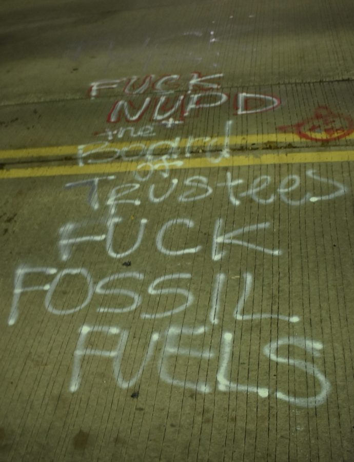 """A tag left on Sheridan Road, reading """"F—k NUPD + the Board of Trustees, F—k fossil fuels."""""""
