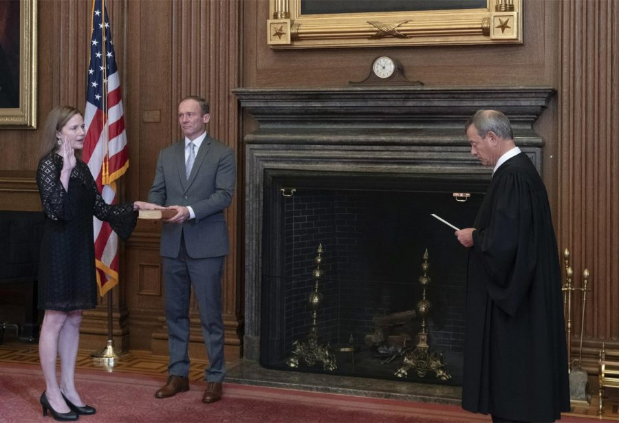 Chief Justice John G. Roberts (R) administers the Judicial Oath to U.S. Supreme Court Associate Justice Amy Coney Barrett. Barrett was confirmed on Monday.