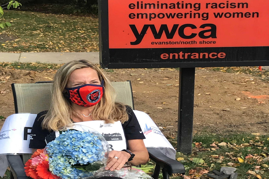 Wolf sits in front of the Evanston YWCA after finishing her marathon. She walked amidst the pandemic to benefit the YWCA.