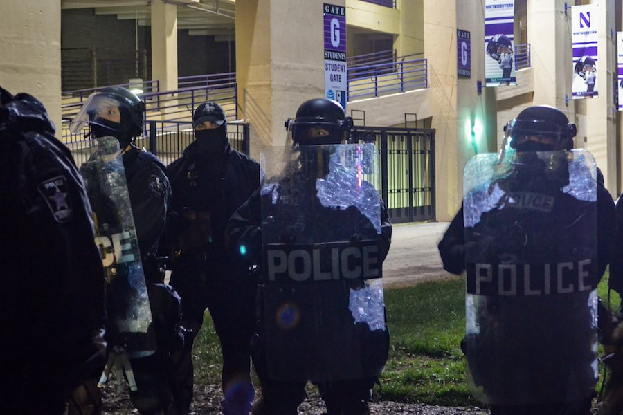 Police officers in riot gear form a barricade on the east side of Ryan Field during the Maryland vs. Northwestern game Saturday.