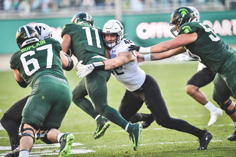 Paddy Fisher makes a tackle. The senior had 12 tackles in NU's loss to Michigan State.