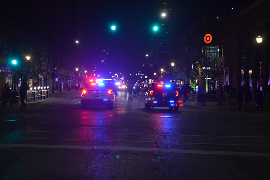 Evanston Police officers block off Sherman Avenue as students disperse following the conclusion of the march.