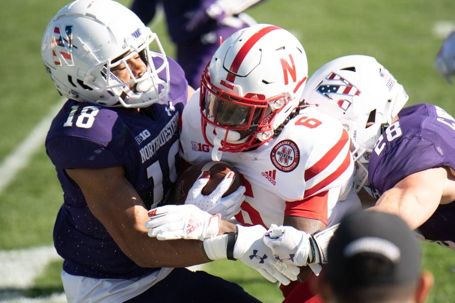 Cam Ruiz and Chris Bergin make a tackle. Northwestern held Nebraska scoreless in the second half of its 21-13 win on Saturdyay.