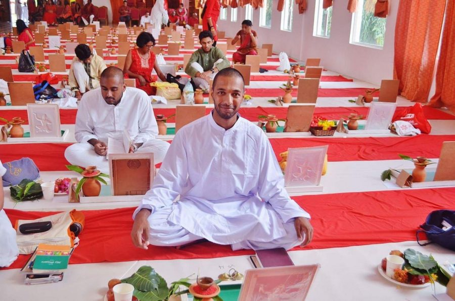 Amar Shah (Weinberg '16) studying as a Hindu monk in Trinidad and Tobago in 2018.
