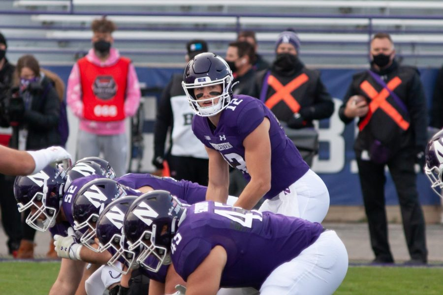 Peyton Ramsey prepares to take the snap. The graduate quarterback and No. 8 Northwestern can clinch the Big Ten West title with a win over Michigan State Saturday.