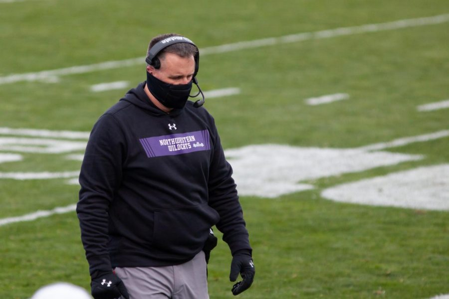 Coach Pat Fitzgerald walks along the sideline. Northwestern's game against Minnesota this Saturday was cancelled Monday afternoon.