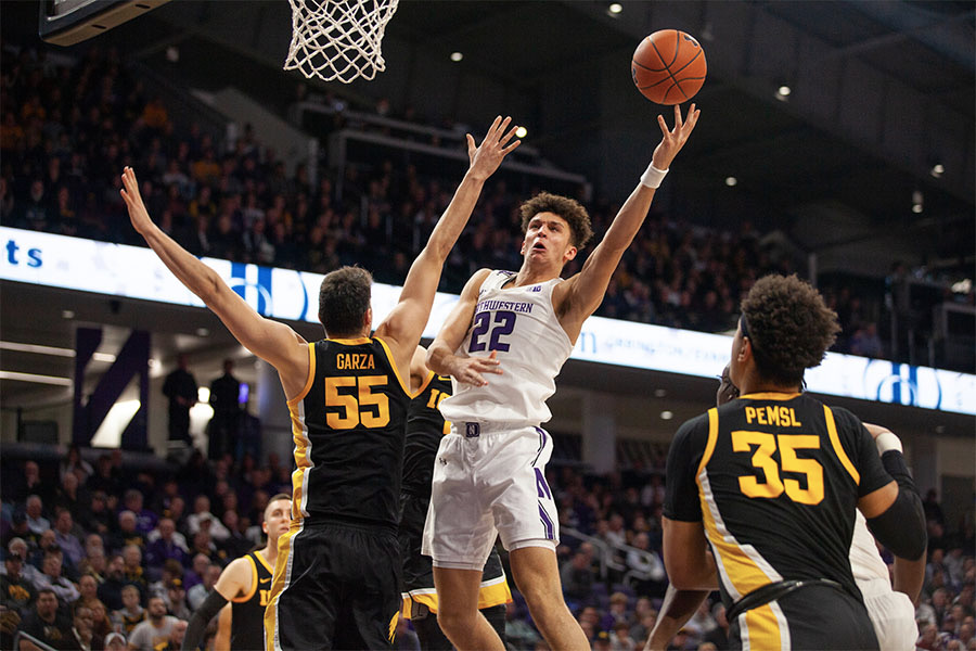 Pete Nance blocks a shot. The junior forward led Northwestern with 21 points in its loss to No. 10 Iowa.