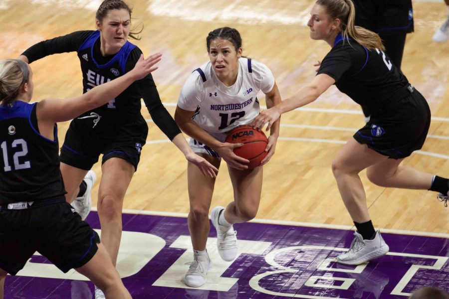 Veronica+Burton+drives+to+the+basket.+Burton+scored+a+career-best+27+points+to+lead+the+Wildcats+to+a+70-54+victory+over+Purdue.%0A