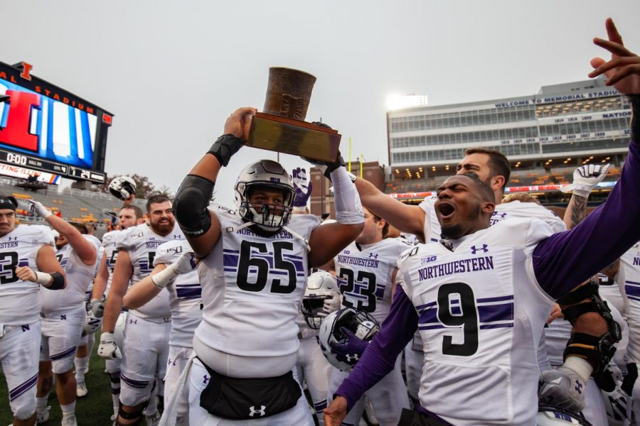 Northwestern players celebrate after being Illinois last season. The Cats have won their last five games against the Fighting Illini.