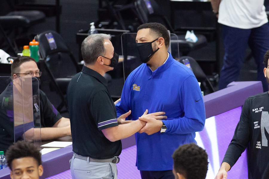 Chris Collins and Jeff Capel speak before Wednesday's game. Capel expressed concerns prior to the game about playing as COVID-19 cases increased nationwide.
