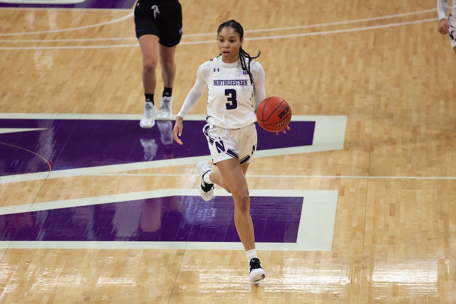 Sydney Wood takes the ball up the court. The junior guard scored 13 points in Northwestern's win over Eastern Kentucky.