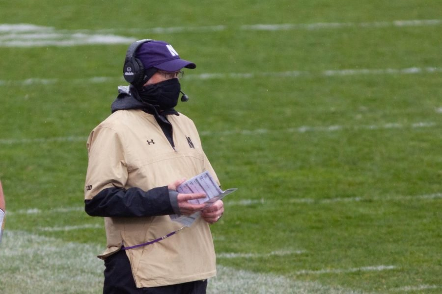Defensive coordinator Mike Hankwitz stands on the sidelines. Hankwitz will be retiring at the end of the 2020 season.