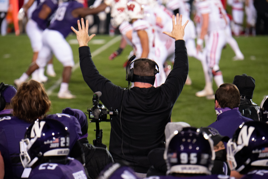 Pat Fitzgerald celebrates the team's win over Wisconsin. The Wildcats clinched their second Big Ten West title in three years.