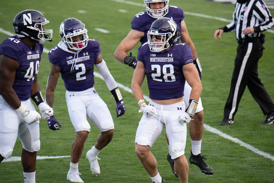 Chris Bergin (28) flexes after a tackle. Bergin, Paddy Fisher (42) and Greg Newsome (2) were All-Big Ten honorees.