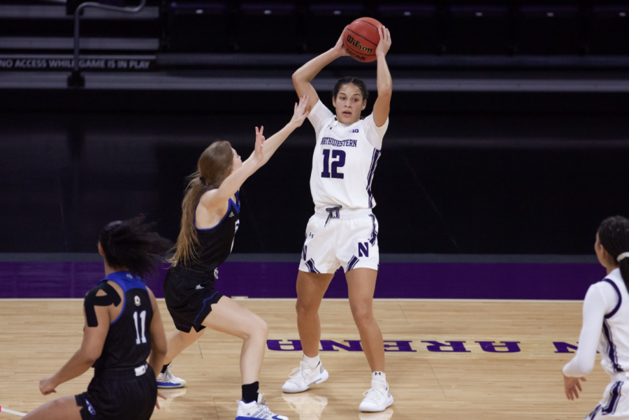 Veronica Burton looks to pass the ball. The junior guard finished with 20 points and a career-high 10 assists in No. 16 Northwestern's win over Minnesota.