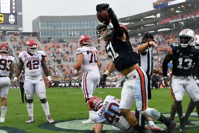 Auburn linebacker Barton Lester (51) reacts after scoring a touchdown on a blocked punt against Arkansas on Oct. 10, 2020.