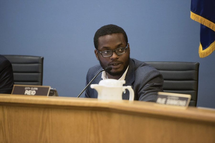 City clerk and 8th Ward aldermanic candidate Devon Reid. Reid made his case for the Eighth Ward seat in a Tuesday debate that escalated after Ald. Rainey made a racially charged remark toward the clerk.