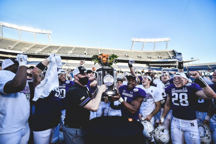 Pat Fitzgerald and Jesse Brown left the Citrus Bowl trophy. Northwestern won the game 35-19.