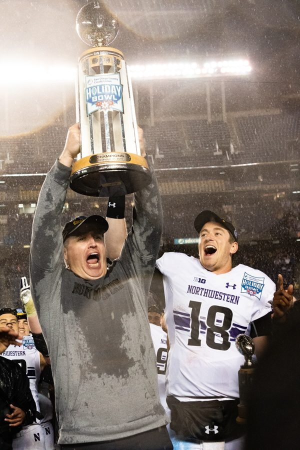 Pat+Fitzgerald+lifts+up+the+Holiday+Bowl+Trophy+after+Northwestern+took+down+Utah+31-20+on+New+Year%27s+Day+in+2019.+He%E2%80%99ll+hope+for+more+celebrations+like+that+in+the+next+ten+years%2C+having+just+signed+a+decade-long+contract+extension+to+stay+at+NU.+