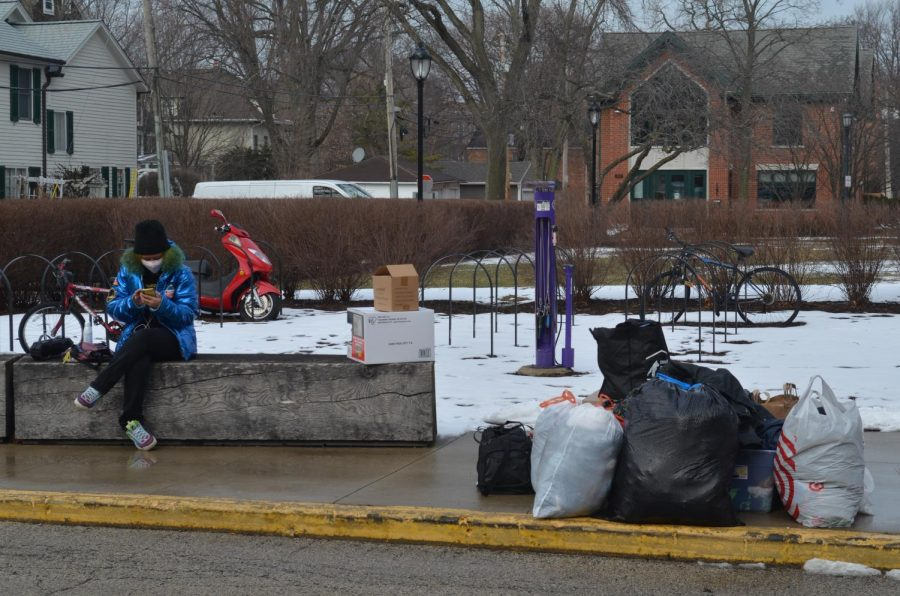 Gonring stationed outside Foster Walker Complex on Sunday, collecting donated winter gear to distribute.