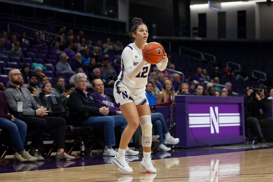 Veronica Burton steps into a three-pointer. Against Penn State Sunday, Burton paced her team with 19 points and four assists.
