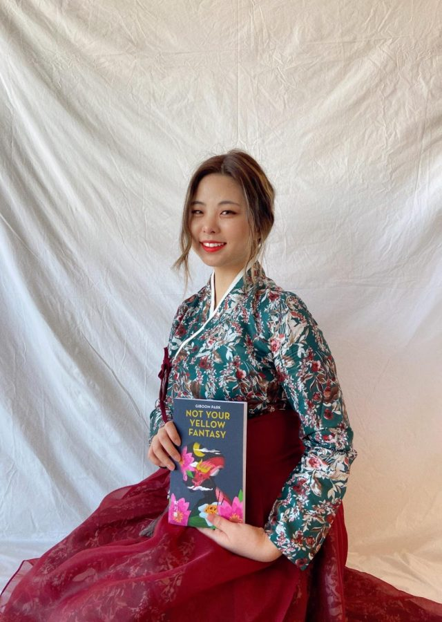 "Giboom (Joyce) Park with her book, ""Not Your Yellow Fantasy: Deconstructing the Legacy of Asian Fetishization."""