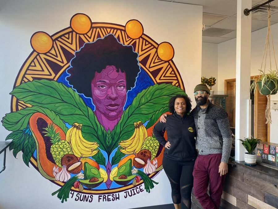 Gabrielle J. Walker, owner of 4 Suns Fresh Juice with muralist David Anthony Geary.