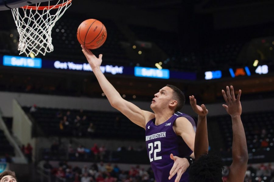 Pete Nance tries a layup. Nance had 12 points and seven rebounds in Northwestern's double-overtime loss.